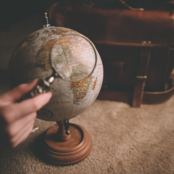 Magnified glass over globe